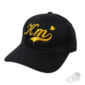 หมวกผ้าพีช บัคเคิลเหล็ก ปักโลโก้ KM ด้านข้าง